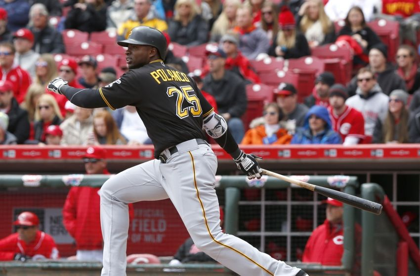 Apr 9, 2016; Cincinnati, OH, USA; Pittsburgh Pirates right fielder Gregory Polanco hits a single during the second inning against the Cincinnati Reds at Great American Ball Park. Mandatory Credit: David Kohl-USA TODAY Sports