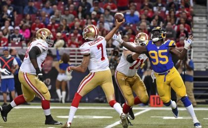 Nov 1, 2015; St. Louis, MO, USA; San Francisco 49ers quarterback Colin Kaepernick (7) passes the ball under pressure from St. Louis Rams defensive end William Hayes (95) during the second half at the Edward Jones Dome. Mandatory Credit: Jasen Vinlove-USA TODAY Sports