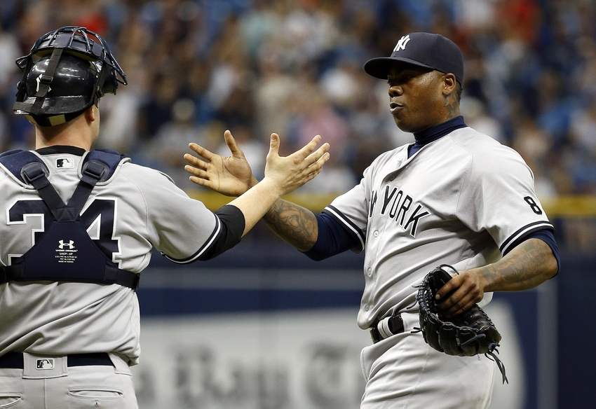 May 29, 2016; St. Petersburg, FL, USA; New York Yankees relief pitcher Aroldis Chapman (54) and catcher Brian McCann (34) high five after defeating the Tampa Bay Rays at Tropicana Field. The Yankees beat the Rays 2-1. Mandatory Credit: Kim Klement-USA TODAY Sports