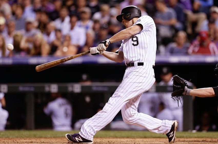 Jun 14, 2016; Denver, CO, USA; Colorado Rockies second baseman DJ LeMahieu (9) hits a single in the seventh inning against the New York Yankees at Coors Field. The Rockies won 13-10. Mandatory Credit: Isaiah J. Downing-USA TODAY Sports