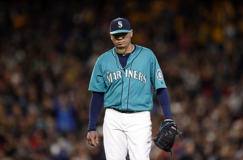 May 27, 2016; Seattle, WA, USA; Seattle Mariners starting pitcher Felix Hernandez (34) walks back to the dugout following the last out of the sixth inning against the Minnesota Twins at Safeco Field. Mandatory Credit: Jennifer Buchanan-USA TODAY Sports