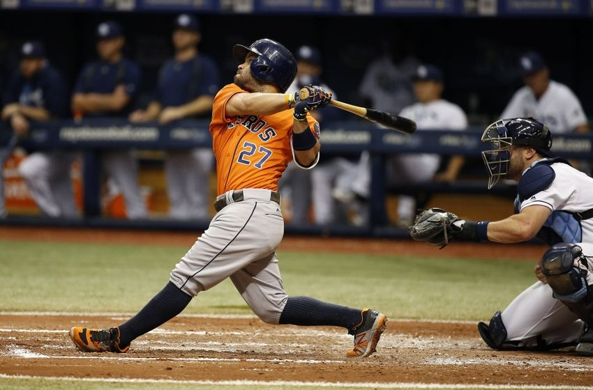 Jun 11, 2016; St. Petersburg, FL, USA; Houston Astros second baseman Jose Altuve (27) hits a sacrifice RBI during the fourth inning against the Tampa Bay Rays at Tropicana Field. Mandatory Credit: Kim Klement-USA TODAY Sports