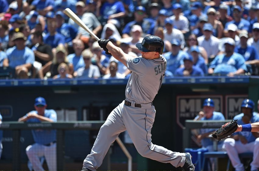 Jul 10, 2016; Kansas City, MO, USA; Seattle Mariners third basemen Kyle Seager (15) singles in two runs against the Kansas City Royals during the first inning at Kauffman Stadium. Mandatory Credit: Peter G. Aiken-USA TODAY Sports
