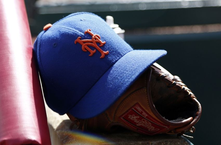 Sep 27, 2015; Cincinnati, OH, USA; A cap and glove sits in the New York Mets dugout during a game against the Cincinnati Reds at Great American Ball Park. The Mets won 8-1. Mandatory Credit: David Kohl-USA TODAY Sport
