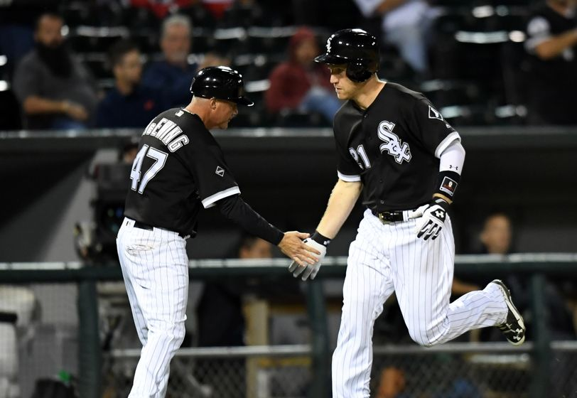 Sep 12, 2016; Chicago, IL, USA; Chicago White Sox third baseman Todd Frazier (right) celebrates his two run home run with third base coach Joe McEwing (left) against the Cleveland Indians during the eighth inning at U.S. Cellular Field. Mandatory Credit: Patrick Gorski-USA TODAY Sports