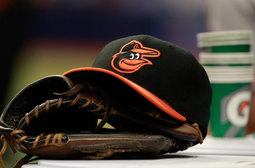 Apr 6, 2015; St. Petersburg, FL, USA; A general view of Baltimore Orioles glove and hat lays in the dugout against the Tampa Bay Rays at Tropicana Field. Mandatory Credit: Kim Klement-USA TODAY Sports