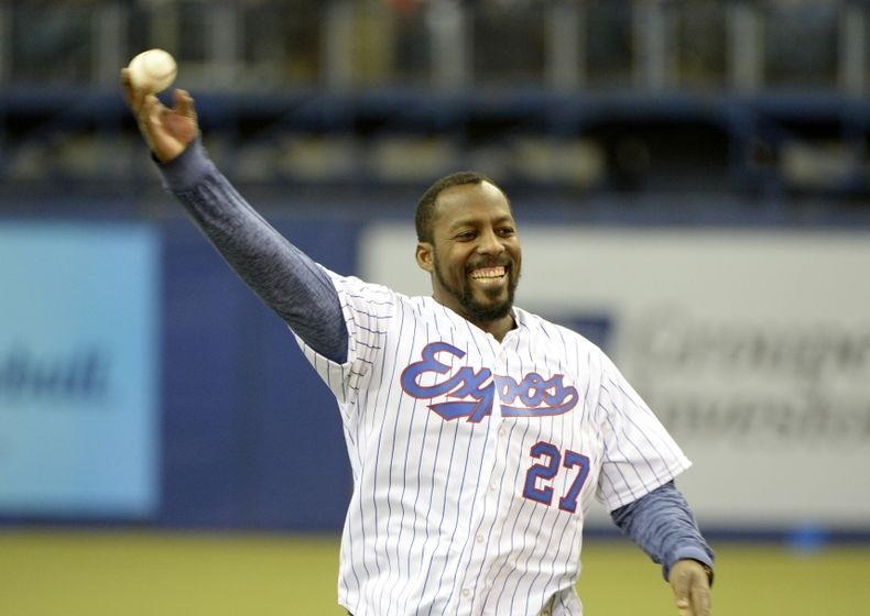 Apr 3, 2015; Montreal, Quebec, CAN; Former Expos Vladimir Guerrero throws the first pitch before the game between the Cincinnati Reds and the Toronto Blue Jays at the Olympic Stadium. Mandatory Credit: Eric Bolte-USA TODAY Sports
