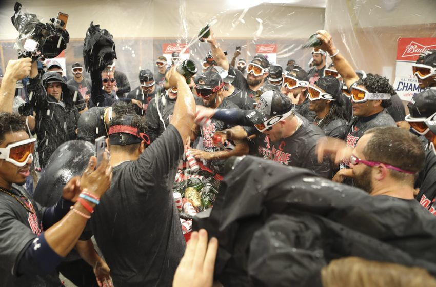 Sep 26, 2016; Detroit, MI, USA; Cleveland Indians celebrate clinching the Central Division title in the clubhouse after the game against the Detroit Tigers at Comerica Park. Indians win 7-4. Mandatory Credit: Raj Mehta-USA TODAY Sports