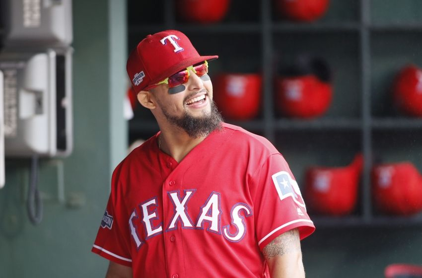 Oct 7, 2016; Arlington, TX, USA; Texas Rangers second baseman Rougned Odor (12) in the dugout prior to game two of the 2016 ALDS playoff baseball series at Globe Life Park in Arlington. Mandatory Credit: Tim Heitman-USA TODAY Sports