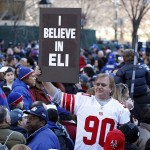Feb 7, 2012; New York, NY, USA; A fan of the New York Giants holds up a sign in support of quarterback Eli Manning (not pictured) during the Super Bowl XLVI victory celebration in downtown Manhattan. Mandatory Credit: William Perlman/THE STAR-LEDGER via US PRESSWIRE