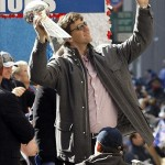 Feb 7, 2012; New York, NY, USA; New York Giants quarterback Eli Manning waves to the crowd as he holds the Vince Lombardi Trophy during the Super Bowl XLVI victory celebration in downtown Manhattan. Mandatory Credit: Andrew Mills/THE STAR-LEDGER via US PRESSWIRE