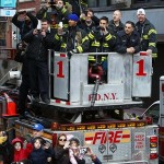 Feb 7, 2012; New York, NY, USA; New York fire department members cheer during the New York Giants parade and Super Bowl XLVI victory celebration in downtown Manhattan. Mandatory Credit: Debby Wong-US PRESSWIRE