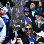 Feb 7, 2012; New York, NY, USA; New York Giants fans cheer and hold up signs during the Super Bowl XLVI victory celebration in downtown Manhattan. Mandatory Credit: Debby Wong-US PRESSWIRE