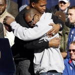 Feb 7, 2012; New York, NY, USA; New York Giants running back Ahmad Bradshaw (right) hugs former player Michael Strahan during the Super Bowl XLVI victory celebration in downtown Manhattan. Mandatory Credit: William Perlman/THE STAR-LEDGER via US PRESSWIRE