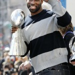 Feb 7, 2012; New York, NY, USA; New York Giants defensive end Justin Tuck holds the Vince Lombardi Trophy during the Super Bowl XLVI victory celebration in downtown Manhattan. Mandatory Credit: Andrew Mills/THE STAR-LEDGER via US PRESSWIRE