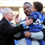 Feb 7, 2012; East Rutherford, NJ, USA; New York Giants head coach Tom Coughlin (left) greets New York Giants defensive end Justin Tuck (middle) and son Jayce Tuck during the Super Bowl XLVI victory celebration at MetLife Stadium. Mandatory Credit: Ed Mulholland-US PRESSWIRE
