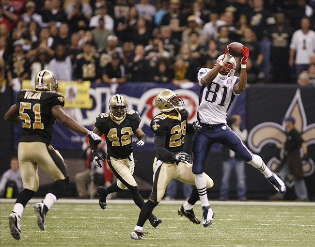 Nov. 30 2009; New Orleans, LA, USA; New England Patriots wide receiver Randy Moss (81) catches a pass in front of New Orleans Saints cornerback Chris McAlister (29) during the second quarter at the Louisiana Superdome. Mandatory Credit: Matt Stamey-US PRESSWIRE