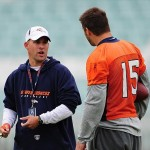 October 29, 2010; London, ENGLAND; Denver Broncos head coach Josh McDaniels (left) talks to quarterback Tim Tebow (15) during practice at the Brit Oval. The Broncos will play the San Francisco 49ers in a regular season game at Wembley Stadium on October 31. Mandatory Credit: Kyle Terada-US PRESSWIRE