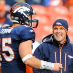 Nov 28, 2010; Denver, CO, USA; Denver Broncos head coach Josh McDaniels and quarterback Tim Tebow (15) talk before the game against the St Louis Rams at Invesco Field. Mandatory Credit: Ron Chenoy-US PRESSWIRE