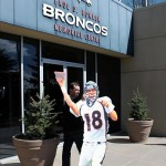 March 20 2012; Englewood, CO, USA; A staff media member of KUSA 9 news brings in a mock cutout of Denver Broncos quarterback Peyton Manning (18) before the start of a press conference at Broncos headquarters. Mandatory Credit: Ron Chenoy-US PRESSWIRE