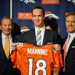 March 20 2012; Englewood, CO, USA; Denver Broncos owner Pat Bowlen (left) and quarterback Peyton Manning (center) and executive vice president of football operations John Elway during a press conference at Broncos headquarters. Mandatory Credit: Ron Chenoy-US PRESSWIRE