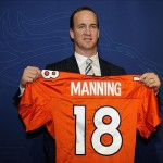 March 20 2012; Englewood, CO, USA; Denver Broncos Peyton Manning (18) holds his jersey after a press conference at Broncos headquarters. Mandatory Credit: Ron Chenoy-US PRESSWIRE