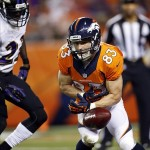 Sep 5, 2013; Denver, CO, USA; Denver Broncos punt returner Wes Welker (83) drops a punt during the first half against the Baltimore Ravens at Sports Authority Field at Mile High. The Ravens recovered the ball. Mandatory Credit: Chris Humphreys-USA TODAY Sports