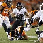 Sep 5, 2013; Denver, CO, USA; Baltimore Ravens running back Ray Rice (27) runs with the ball during the first half against the Denver Broncos at Sports Authority Field at Mile High. Mandatory Credit: Chris Humphreys-USA TODAY Sports