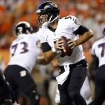 Sep 5, 2013; Denver, CO, USA; Baltimore Ravens quarterback Joe Flacco (5) rolls out of the pocket during the first half against the Denver Broncos at Sports Authority Field at Mile High. Mandatory Credit: Chris Humphreys-USA TODAY Sports