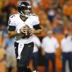 Sep 5, 2013; Denver, CO, USA; Baltimore Ravens quarterback Joe Flacco (5) looks to pass the ball during the first half against the Denver Broncos at Sports Authority Field at Mile High. Mandatory Credit: Chris Humphreys-USA TODAY Sports