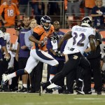 Sep 5, 2013; Denver, CO, USA; Denver Broncos tight end Julius Thomas (80) runs after a reception as Baltimore Ravens strong safety James Ihedigbo (32) defends in the second quarter at Sports Authority Field at Mile High. Mandatory Credit: Ron Chenoy-USA TODAY Sports