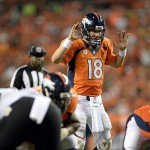 Sep 5, 2013; Denver, CO, USA; Denver Broncos quarterback Peyton Manning (18) at the line of scrimmage in the third quarter against the Baltimore Ravens at Sports Authority Field at Mile High. Mandatory Credit: Ron Chenoy-USA TODAY Sports