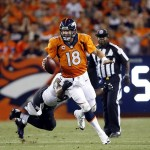Sep 5, 2013; Denver, CO, USA; Denver Broncos quarterback Peyton Manning scrambles out of the pocket during the second half against the Baltimore Ravens at Sports Authority Field at Mile High. Mandatory Credit: Chris Humphreys-USA TODAY Sports