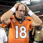 Sep 5, 2013; Denver, CO, USA; Denver Broncos quarterback Peyton Manning (18) reacts following win over the Baltimore Ravens at Sports Authority Field at Mile High. The Broncos defeated the Ravens 49-27. Mandatory Credit: Ron Chenoy-USA TODAY Sports