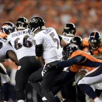 Sep 5, 2013; Denver, CO, USA; Baltimore Ravens quarterback Joe Flacco (5) is sacked by Denver Broncos outside linebacker Shaun Phillips (90) in the third quarter at Sports Authority Field at Mile High. The Broncos defeated the Ravens 49-27. Mandatory Credit: Ron Chenoy-USA TODAY Sports