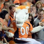 Sep 5, 2013; Denver, CO, USA; Denver Broncos mascot Miles reacts with the crowd during the game against the Baltimore Ravens at Sports Authority Field at Mile High. The Broncos defeated the Ravens 49-27. Mandatory Credit: Ron Chenoy-USA TODAY Sports
