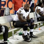 Sep 5, 2013; Denver, CO, USA; Baltimore Ravens defensive end Marcus Spears (96) reacts on the bench late in the fourth quarter against the Denver Broncos at Sports Authority Field at Mile High. The Broncos defeated the Ravens 49-27. Mandatory Credit: Ron Chenoy-USA TODAY Sports