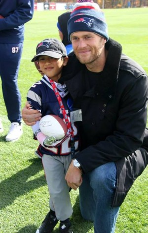 "New England Patriots QB Tom Brady at the ""Make A Wish"" event with fingers taped. Credit: Patriots Facebook Page."