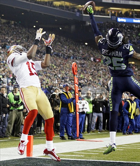 Jan 19, 2014; Seattle, WA, USA; Seattle Seahawks cornerback Richard Sherman (25) tips a pass intended for San Francisco 49ers wide receiver Michael Crabtree (15) that is intercepted by Seahawks outside linebacker Malcolm Smith (not pictured) in the fourth quarter of the 2013 NFC Championship game at CenturyLink Field. Mandatory Credit: William Perlman/THE STAR-LEDGER via USA TODAY Sports