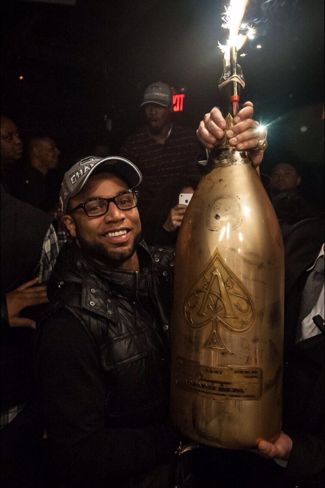 Seattle Seahawks WR Golden Tate celebrating with a $100,000 bottle of champagne