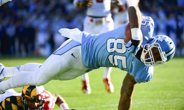 Nov 24, 2012; Chapel Hill, NC, USA; North Carolina Tar Heels tight end Eric Ebron (85) scores a touchdown as Maryland Terrapins defensive back Matt Robinson (40) defends in the first quarter at Kenan Stadium. Mandatory Credit: Bob Donnan-USA TODAY Sports