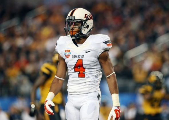 Jan 3, 2014; Arlington, TX, USA; Oklahoma State Cowboys cornerback Justin Gilbert (4) reacts during the game against the Missouri Tigers in the 2014 Cotton Bowl at AT&T Stadium. Missouri won 41-31. Mandatory Credit: Kevin Jairaj-USA TODAY Sports