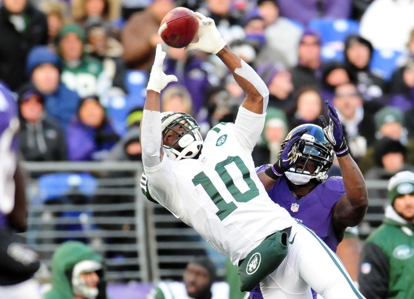 Nov 24, 2013; Baltimore, MD, USA; New York Jets wide receiver Santonio Holmes (10) catches the ball as Baltimore Ravens safety James Ihedigbo (32) defends at M&T Bank Stadium. The Ravens won 19-3. Mandatory Credit: Evan Habeeb-USA TODAY Sports