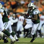 Aug 16, 2014; Cincinnati, OH, USA; New York Jets running back Chris Johnson (21) runs with the ball during the second quarter against the Cincinnati Bengals at Paul Brown Stadium. Mandatory Credit: Andrew Weber-USA TODAY Sports