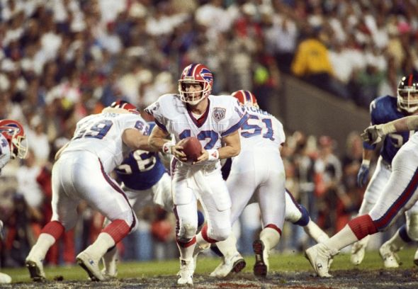 Jan 27, 1991; Tampa, FL, USA; FILE PHOTO; Buffalo Bills quarterback Jim Kelly (12) carries the ball against the New York Giants during Super Bowl XXV at Tampa Stadium. The Giants defeated the Bills 19-20. Mandatory Credit: USA TODAY Sports