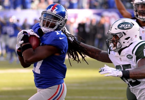 Dec 6, 2015; East Rutherford, NJ, USA; New York Giants wide receiver Dwayne Harris (17) returns a punt for touchdown against New York Jets tight end Jeff Cumberland (85) at MetLife Stadium. Mandatory Credit: Robert Deutsch-USA TODAY Sports