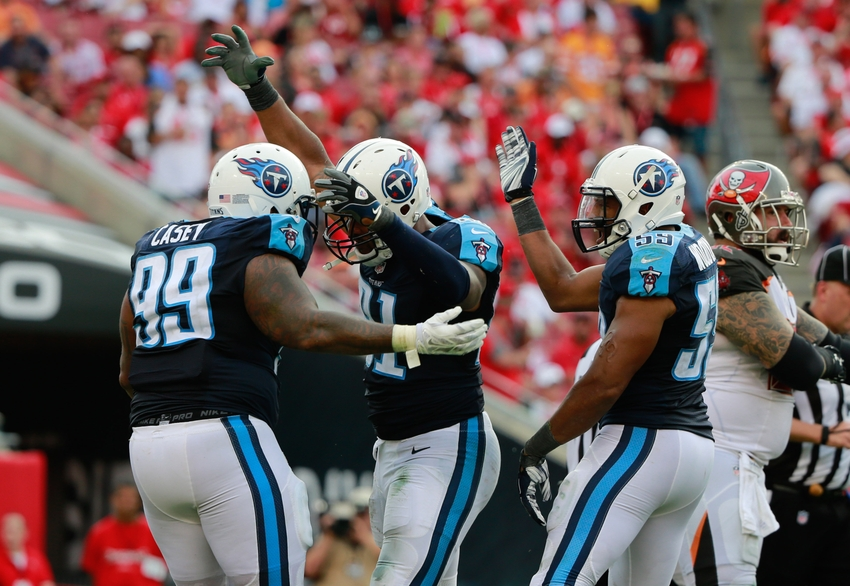 Sep 13, 2015; Tampa, FL, USA; Tennessee Titans outside linebacker Derrick Morgan (91) reacts with defensive tackle Jurrell Casey (99) as he sacked Tampa Bay Buccaneers quarterback Jameis Winston (not pictured) during the second half at Raymond James Stadium. Tennessee Titans defeated the Tampa Bay Buccaneers 42-14. Mandatory Credit: Kim Klement-USA TODAY Sports