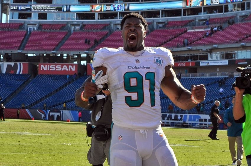 Oct 18, 2015; Nashville, TN, USA; Miami Dolphins defensive end Cameron Wake (91) celebrates as he leaves the field after his team defeated the Tennessee Titans during the second half at Nissan Stadium. Miami won 38-10. Mandatory Credit: Jim Brown-USA TODAY Sports