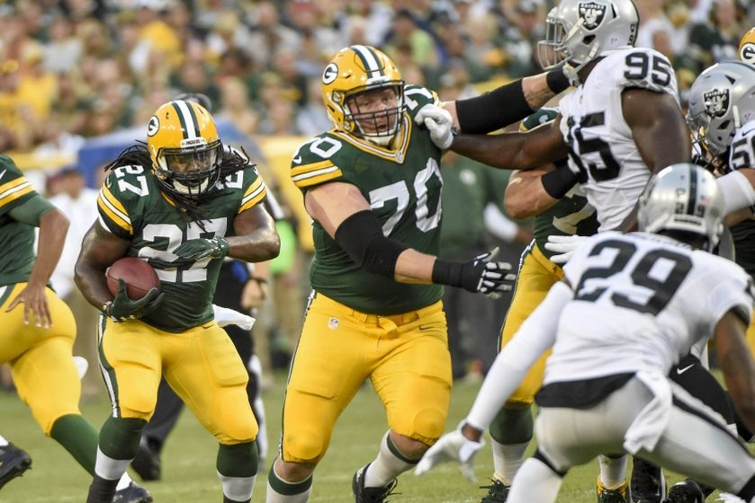 Green Bay Packers running back Eddie Lacy (27) follows a block by guard T.J. Lang (70) in the first quarter during the game against the Oakland Raiders at Lambeau Field.