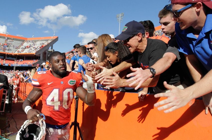 Nov 7, 2015; Gainesville, FL, USA; Florida Gators linebacker Jarrad Davis (40) high five fans as they beat the Vanderbilt Commodores at Ben Hill Griffin Stadium. Florida Gators defeated the Vanderbilt Commodores 9-7. Mandatory Credit: Kim Klement-USA TODAY Sports